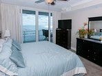 Master bedroom with flat screen TV/DVD and private balcony access