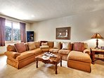 Spread out and relax on the large sectional couch.