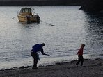 Skipping Stones on the beach at the end of a day in Port Isaac