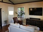 Open living area with vaulted ceilings, 55' 4K Ultra TV and Yamaha sound bar