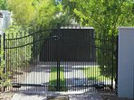 Secure off-street parking behind locked automatic driveway security gate