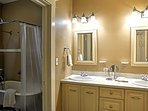 Freshen up in this  pristine bathroom with duel sinks before heading to dinner at one of New Orleans' finest...