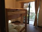 Bedroom 2 has double bunk bed, walk out to rear balcony, great mountain views.