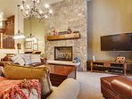 Main level lounge with gas fireplace and large TV