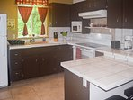 Flat top electric range, microwave and small appliances are provided
