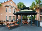 A sundeck and a gazebo area with picnic tables and gas grills are waiting for you.