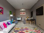 Playroom area which contains a 50' HDTV with really interesting table games!