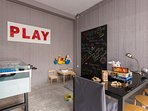 Football table game and other toys for all ages.