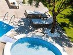 Enjoy the sun next to the pool!