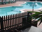 Communial pool with sunbeds