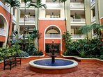 The beautiful resort-like courtyards of Marbella welcome you home.