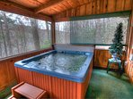 Relax in hot tub while taking in the views