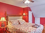 A bright crimson completes this third bedroom.