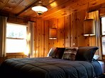 Indulge in a king size bed decorated with rustic lamps