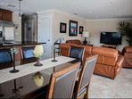 Spacious, open living space with dining room and living room, each comfortably accommodating 6 guests