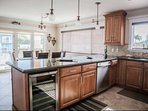 Huge, open kitchen - fully stocked, including wine refrigerator, dish washer and coffee maker.