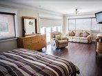 Master suite with private living area, private balcony with water views and flat screen TV