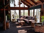 Lower livong room and dining area. Includes fireplace and large deck with bbq grill.