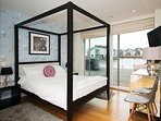 Contempoary four poster bed, to the ground floor, ensuite master bedroom suite