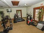 Fitness room located through double french doors, just off lobby.