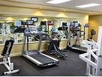 The large fitness room is complete with all the equipment you need for a workout