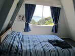 Main double bedroom overlooking the bay and islands