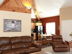 Recline on the leather sofa and chair by the fireplace in the living room