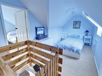 Two twin bedrooms are approached by a 1930s wooden loft ladder - suitable for adventurous older children and adults!