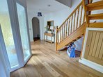 Large hallway with oak floor as throughout