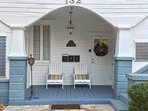 Covered front porch with adirondack chairs