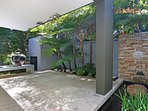 SHADY PATIO WITH FISH POND AND FOUNTAIN LEADS FROM TV ROOM