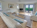 Lounge with French doors to patios, outstanding lovely views to the Axe cliffs & Valley