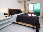 Spacious master bedroom with ensuite bathroom and access to large terrace overlooking ocean