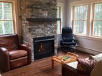 A ledge stone surrounded gas fireplace is lovely.