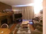 Living room with HDTV, sleeper sofa, fireplace, balcony, views