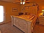 Main Floor Bedroom #1 | Exit Door to Private Hot Tub