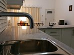 Our Fully Equipped Kitchen with Breakfast Counter comes with all the amenities of home