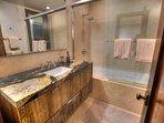 2nd Master (basement level) large soaking tub + shower, single vanity sink.