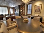 Dining area with custom tree cross section dining table and designer arm chairs for 8