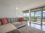 Downstairs TV Room enjoys access to the deck and those impressive views.