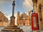 Gharb village centre with The Famous Red Telephone Box