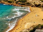 Gold Sands of Ramla Bay just few minutes walk from Farmhouse
