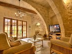 Living area with stone vaulted ceilings