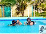 Guest receive snorkel lesson in pool with instructor from onsite scuba and snorkel school