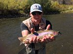 Me with a Yampa rainbow, a 20 min. walk to the river form the unit.