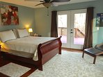 Large master bedroom with private access to the deck area. Comfortable pillow-top queen mattress