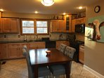 Fully equipped kitchen with dining table that seats 6.  Four more can be seated upstairs.