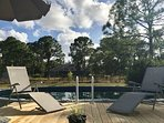 New 24 Ft Pool with deck and beach area with firepit