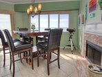 Raised dining room table lends to beautiful Gulf front views at Beach Cottage