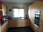 Well equipped kitchen with granite work tops. Everything there a cook could need.